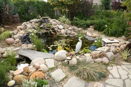 A large water feature turns a small backyard into a delightful summer retreat. photo