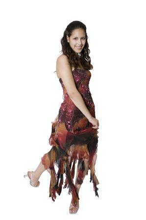 strapless: A teenage girl swirls around to show off her graduationprom dress. Stock Photo