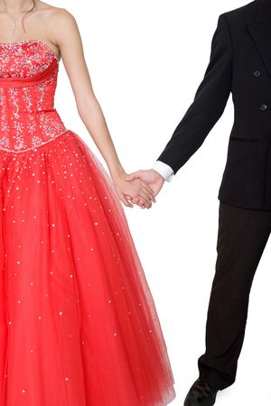strapless dress: Boy & girl, in formal attire, holding hands against a white background.