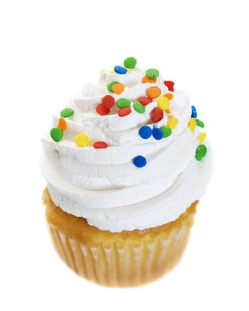 A single cupcake heaped with icing and colorful candy sprinkles.  Shot on white background.