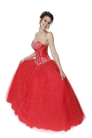 Pretty young woman in a beautiful strapless ball gown. photo