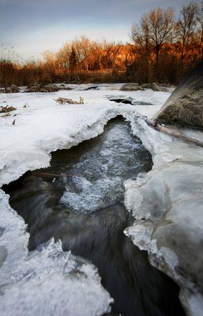 A half frozen river in November.  Shot in early morning.  Kin Coulee, Medicine Hat, Alberta, Canada. Stock Photo - 4068794