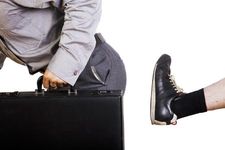 An annoying, door-to-door salesman gets the boot.  Stock Photo