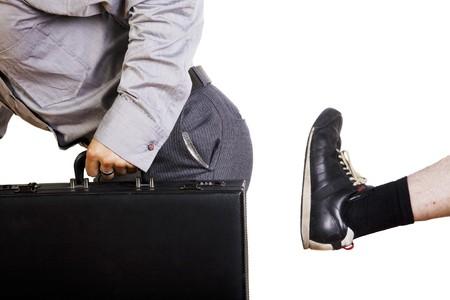 kick: Un fastidioso, porta a porta venditore riceve il boot. Archivio Fotografico