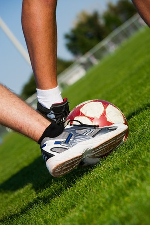 Two men's feet fighting for the soccer ball. Stock Photo - 4145327