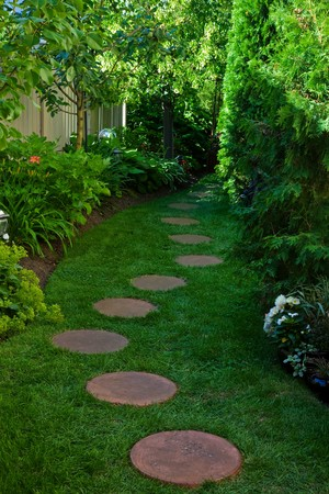 shady: A side garden featuring a shady stepping stone path. Stock Photo