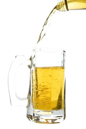 Beer being poured into a beer mug.  Shot on white background.