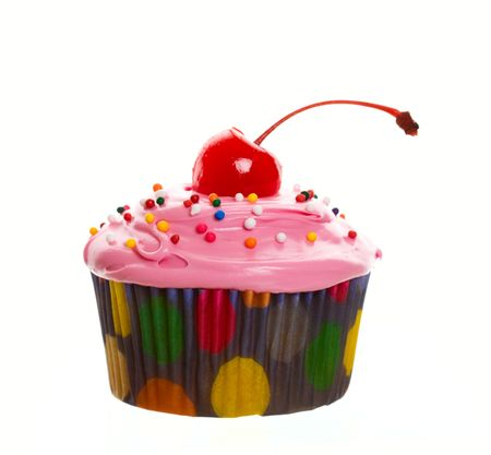 Delectable pink cupcake topped with a cherry and multi-colored sprinkles.  Shot on white background. Stock Photo