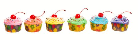 mouthwatering: A rainbow panorama of colorful, mouth-watering cherry cupcakes.   Stock Photo