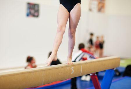 A gymnastics competitor on the balance beam.