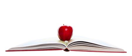 A rosy, red apple on a school atlas.