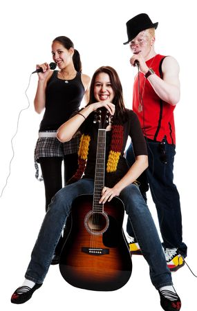 Two mixed race girls and an albino african guy in a musical trio.  Shot on white background. photo