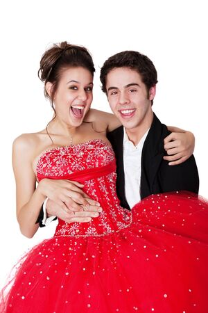 A young man sweeps his prom date off her feet. Stock Photo