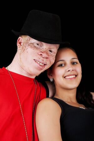 albino: A young African albino man with a mixed-race Caucasian, African-American girl. Stock Photo