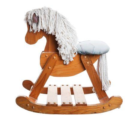 juguetes antiguos: Una �poca, la infancia mecedora caballo. Disparo en el fondo blanco.