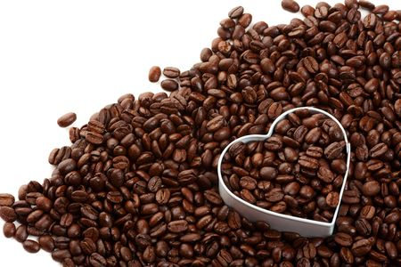 Coffee beans with a heart shape; metaphor for the coffee lovers. Reklamní fotografie