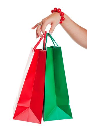 Christmas shopper with red and green shopping bags.  Shot on white background. Stock Photo - 5226503