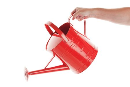 A mans hand with red watering can on white background.