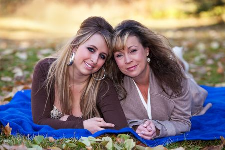 Fall portrait of a mother and daughter. photo