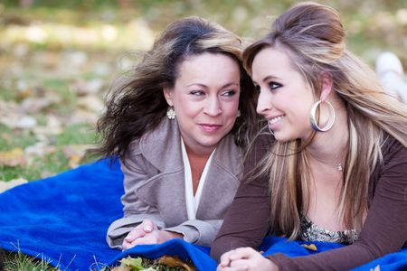 A mother looks lovingly at her daughter.  Shallow depth of field with focus on mother's expression. Stock Photo - 5796717