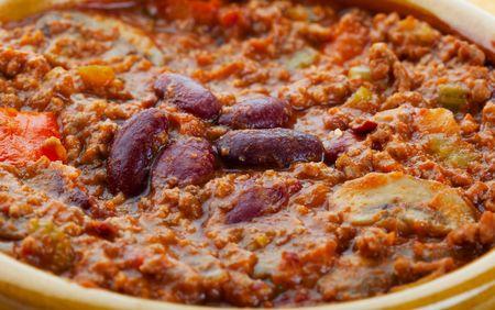 A closeup of chili con carne in a bowl. photo