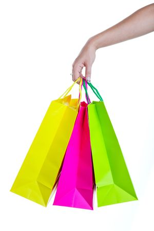 Shopper holding shopping bags, in bright spring colors. Shot on white background.