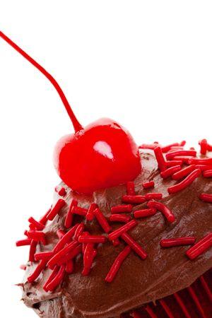 decadent: Decadent chocolate cherry cupcake macro.   Shot on white background.