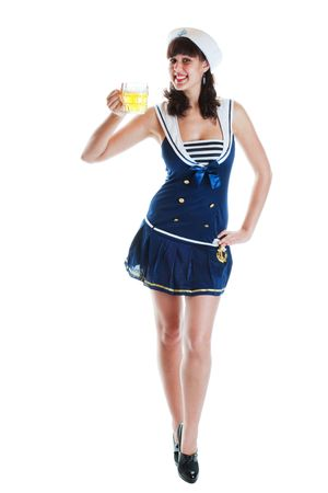 Pretty, young pinup girl in sailor suit holding a mug of beer.  Shot on white background. photo
