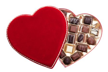heart shaped: Red velvet, heart shaped box of chocolates.  Shot on white background.