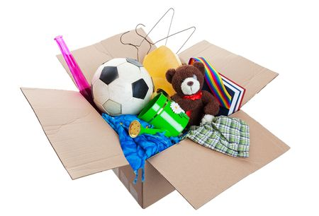 A box of unwanted stuff ready for a garage sale or to donate to a charitable organization.  Shot on white background. Stock Photo - 6353050
