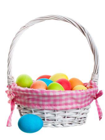 An Easter Basket full of freshly dyed eggs. Shot on white background. Stock Photo - 6432696