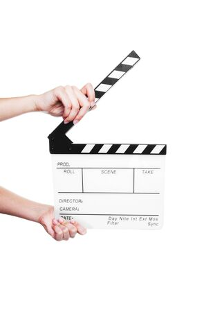 Hands holding out a clapper board.  Shot on white background. Stock Photo - 6911376