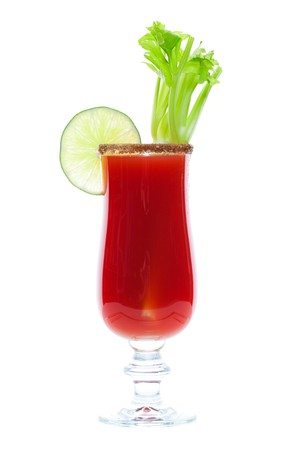 Caesar made with vodka and clamato, served in a spicy rimmed glass with fresh celery and a lime garnish.  Shot on white background.