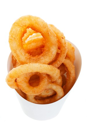 takeout: Golden brown, deep fried onion rings in a generic takeout container.  Shot on white background.