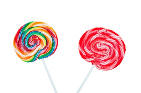 Swirled and colorful candy lollipops on white background.