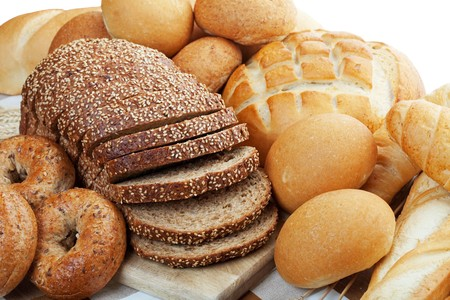 An assortment of freshly baked breads.  Shallow depth of field. photo