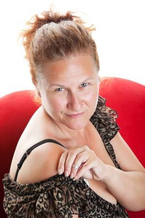 Portrait of a confident, fifty year-old woman with hair pulled back and no makeup on.  Shot on white background. photo