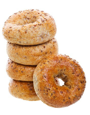 A stack of golden brown, multi-grain bagels.  Shot on white background. photo