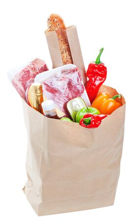 A brown paper bag stuffed with groceries.  Shot on white background. photo