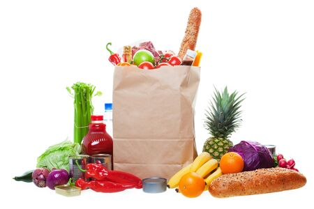 A paper bag full of groceries, surrounded by a panorama of fruits, vegetables, bread, bottled beverages, and canned goods.  White background with light drop shadow. photo