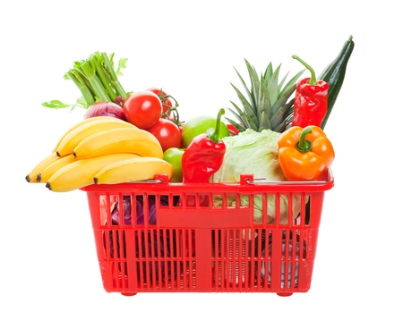 mercearia: A grocery basket filled with fresh fruits, vegetables, and canned goods.  Shot on white background.