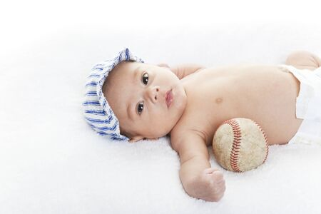 native american baby: Mixed race baby boy with baseball and cap.  Future baseball player.