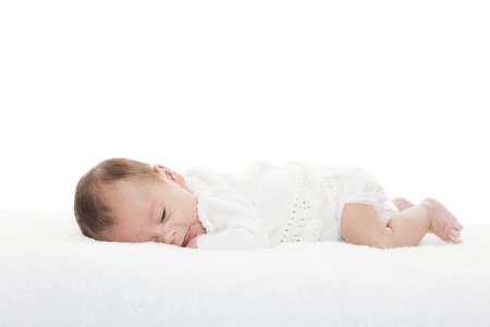 native american baby: A newborn infant about to take a nap.  Mixed race baby shot on white background. Stock Photo