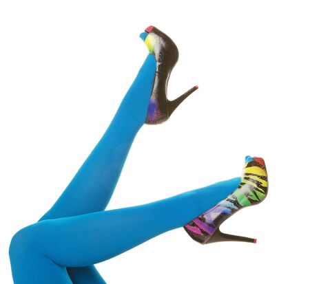 Bright turquoise blue nylon stockings paired with rainbow colored zebra stripe high heels.  Shot on white background.
