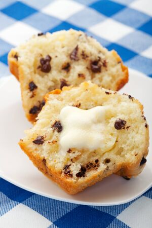 A warm, freshly baked, chocolate chip muffin, with melting butter.