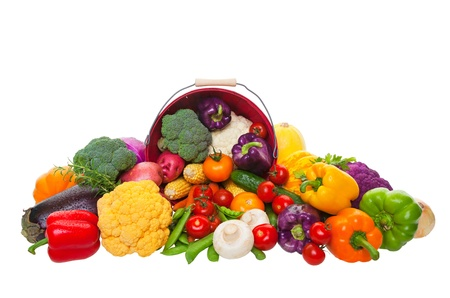 A farmers market display of fresh vegetables with a red bushel basket.  Shot on white background. Stock Photo