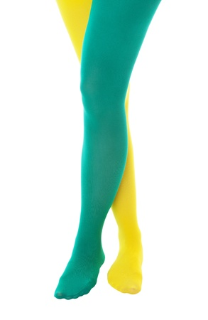 stockings feet: A girl showing team  or school spirit by wearing a green and a yellow stocking.  Shot on white background.