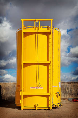 Newly manufactured and coated sloped bottom oil storage tank on skid   Alberta, Canada  Stock Photo