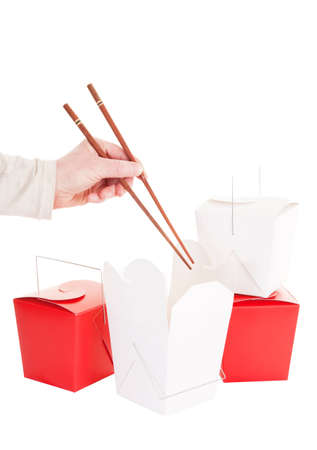 takeout: A hand with chopsticks about to dig into some Chinese take-out food  Stock Photo