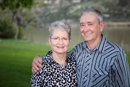 A lovely portrait of  a happy Canadian senior couple outdoors   Stock Photo - 13186469